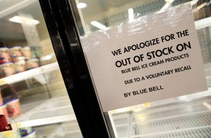 Shelves are bare and signs are posted where Blue Bell products were displayed in a grocery store on April 21, 2015 in Overland Park, Kansas. Blue Bell Creameries recalled all products following a Listeria contamination.