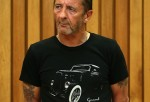 AC/DC drummer Phil Rudd appears in court after being charged with threatening to kill and possession of meth and marijuana at Tauranga District Court on November 26, 2014 in Tauranga, New Zealand.