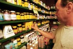 Man looking at vitamins and dietary supplements