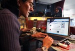 A man looks at a laptop computer displaying Facebook in a cafe on January 27, 2011 in Cairo, Egypt.