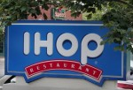 Signs mark the locations of neighboring IHOP and Applebee's restaurants July 16, 2007 in Elgin, Illinois. IHOP has agreed to purchase the Applebee's restaurant chain for about $2 billion.