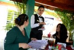 A waitress takes the orders from customers at the restaurant 'El Balcon' a restaurant run out of a private home on February 25, 2015 in Havana, Cuba.