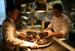 Chef and Waiter in a Restaurant