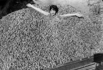 Woman Nearly Submerged in Walnuts