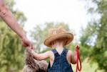 Toddler walking with Pet dog