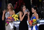 (L-R) Miss Colombia 2015, Ariadna Gutierrez, has her crown removed by Miss Universe 2014, Paulina Vega, and given to the winner of Miss Universe 2015, Miss Phillipines 2015, Pia Alonzo Wurtzbach.