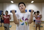 Tears run down the cheeks of an overweight Chinese student