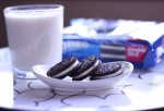 Oreo cookies and glass of milk