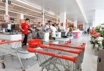 Shopping carts stand near the checkout counters in a Coles supermarket, operated by Wesfarmers Ltd., in Melbourne, Australia, on Tuesday, Feb. 23, 2016. Wesfarmers, Australia's largest retailer, is scheduled to report interim results on Feb. 24. Photograp