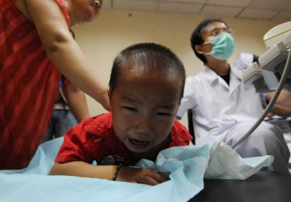 A baby, who drank tainted milk powders, receives type-B ultrasonic examination in a Hospital on September 17, 2008 in Wuhan of Hubei Province, China. A new study has found evidence that food poisoning results in augmented suicidal behavior.