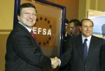 Silvio Berlusconi (R) and Jose Manuel Durao Barroso schakes their hands in front of the label of Efsa at Palazzo Ducale for European Food Safety Authority Inaugural Ceremony on June 21, 2005 in Parma, Italy. The European Food Safety Authority (EFSA) is th