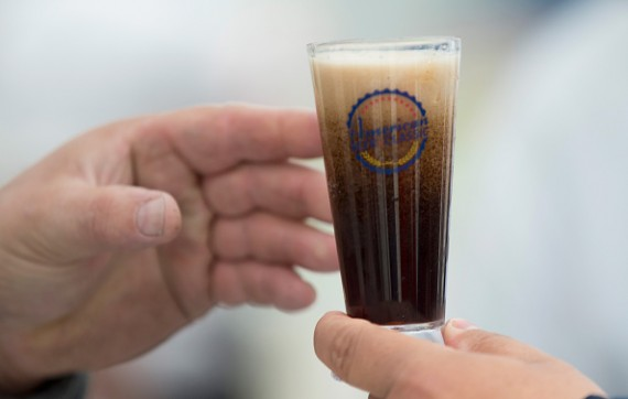 Small Town Brewery offers a sample of their Not Your Father's Root Beer spiced beer at the American Beer Classic craft beer festival at Soldier Field on May 9, 2015 in Chicago, Illinois.